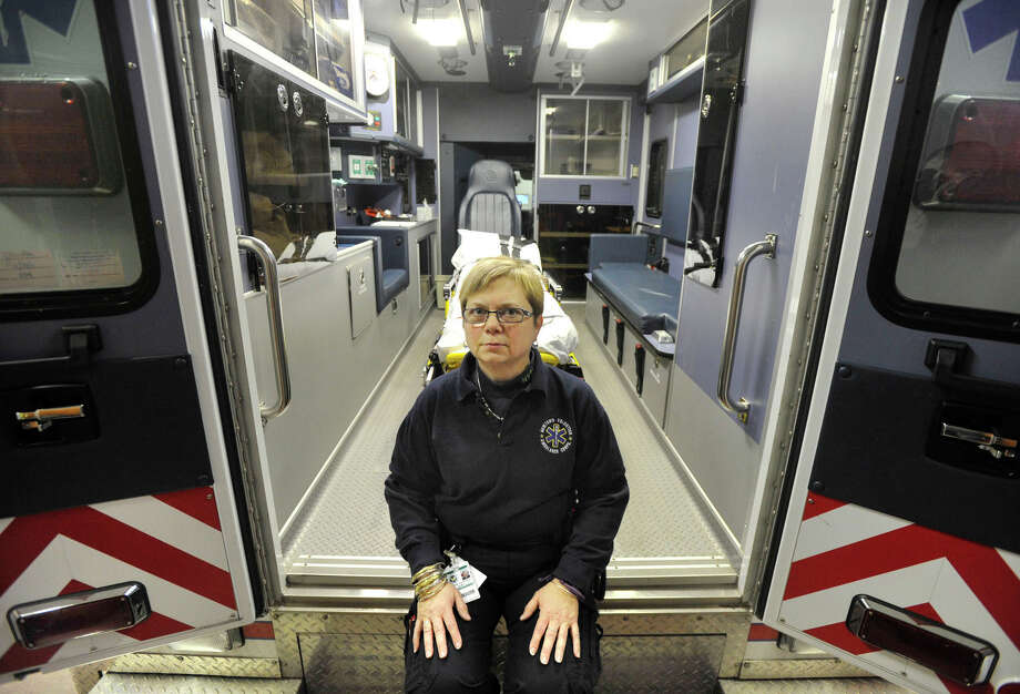EMT volunteer Cathy Dahlmeyer was one of the first rescue workers to arrive at the Sandy Hook shooting. Shortly after her ambulance pulled in to the parking lot, a police officer brought in a child who had been shot. Photo: Jason Rearick, Danbury News-Times / The News-Times
