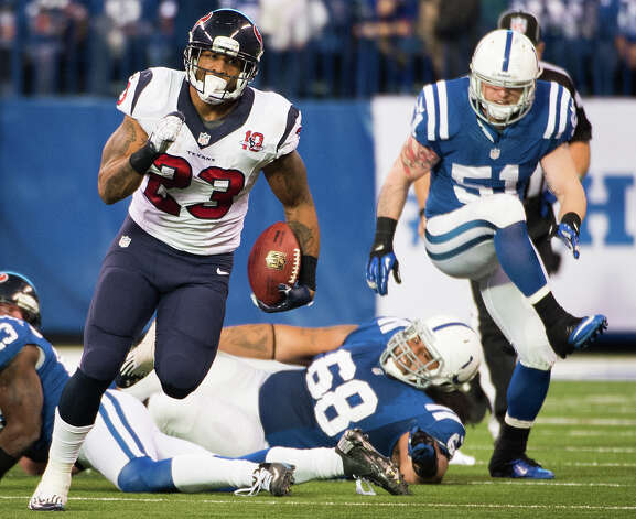 Texans running back Arian Foster (23) races past Indianapolis Colts nose tackle Martin Tevaseu (68) and inside linebacker Pat Angerer (51) for a 39-yard gain during the third quarter. Photo: Smiley N. Pool, Houston Chronicle / © 2012  Houston Chronicle