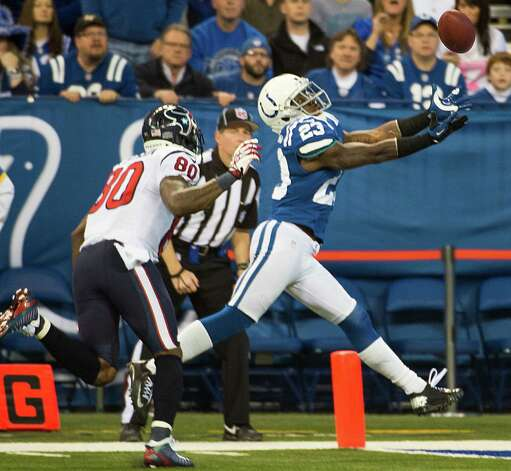 Colts cornerback Vontae Davis (23) intercepts a pass intended for Texans wide receiver Andre Johnson (80) during the fourth quarter. Photo: Smiley N. Pool, Houston Chronicle / © 2012  Houston Chronicle
