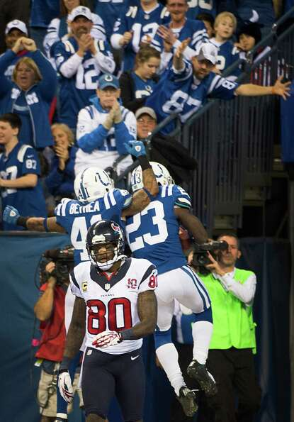 Texans wide receiver Andre Johnson (80) walks away as Colts cornerback Vontae Davis (23) celebrates