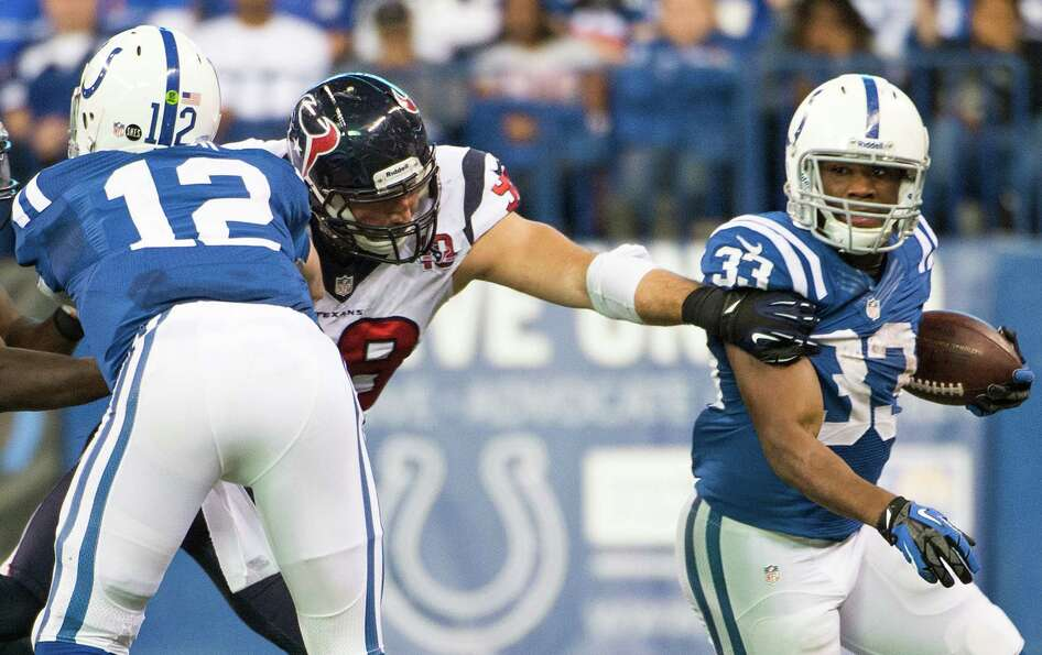 Colts running back Vick Ballard (33) gets a block from quarterback Andrew Luck (12) to slip past Tex