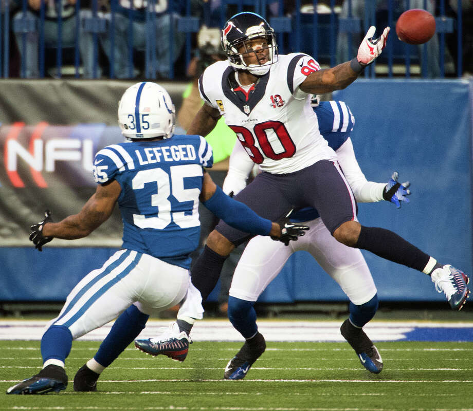 Texans wide receiver Andre Johnson (80) can't hold on to a pass as Indianapolis Colts strong safety Joe Lefeged (35) defends during the third quarter. Photo: Smiley N. Pool, Houston Chronicle / © 2012  Houston Chronicle