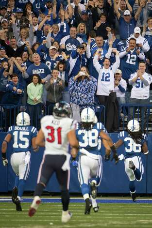 Deji Karim of the Indianapolis Colts races for the end zone as he returns a kickoff 101-yards for a touchdown against the Houston Texans during the third quarter. Photo: Smiley N. Pool, Houston Chronicle / © 2012  Houston Chronicle