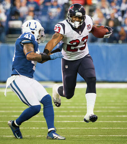 Texans running back Arian Foster (23) is brought down by Colts free safety Antoine Bethea (41) after a 39-yard gain. Photo: Smiley N. Pool, Houston Chronicle / © 2012  Houston Chronicle