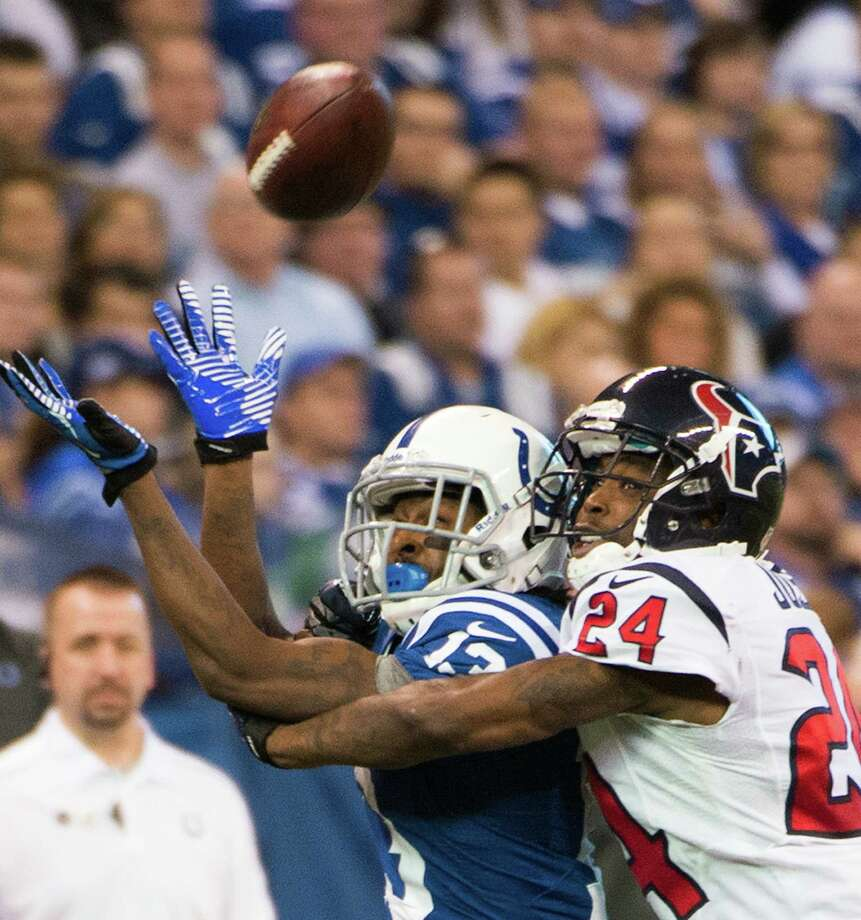 Texans cornerback Johnathan Joseph (24) breaks up a pass intended for Colts wide receiver T.Y. Hilton (13) during the third quarter. Photo: Smiley N. Pool, Houston Chronicle / © 2012  Houston Chronicle