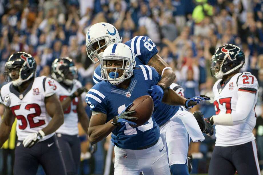 Colts wide receiver T.Y. Hilton (13) celebrates with tight end Dwayne Allen (83) after catching a pass to give the Colts a first down at the Houston Texans 1-yard line during the second quarter. Photo: Smiley N. Pool, Houston Chronicle / © 2012  Houston Chronicle