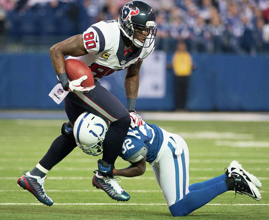 Texans wide receiver Andre Johnson (80) is tripped up by Indianapolis Colts cornerback Cassius Vaughn (32) during the second quarter. Photo: Smiley N. Pool, Houston Chronicle / © 2012  Houston Chronicle