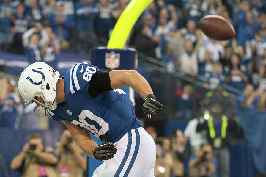 Colts tight end Coby Fleener spikes the ball in celebration after scoring on a 1-yard touchdown pass