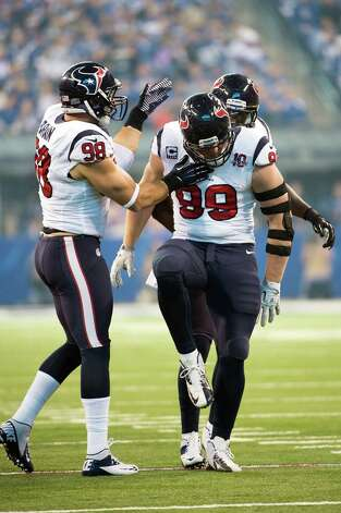 Texans defensive end J.J. Watt (99) celebrates after making a stop on a running play during the first quarter. Photo: Smiley N. Pool, Houston Chronicle / © 2012  Houston Chronicle