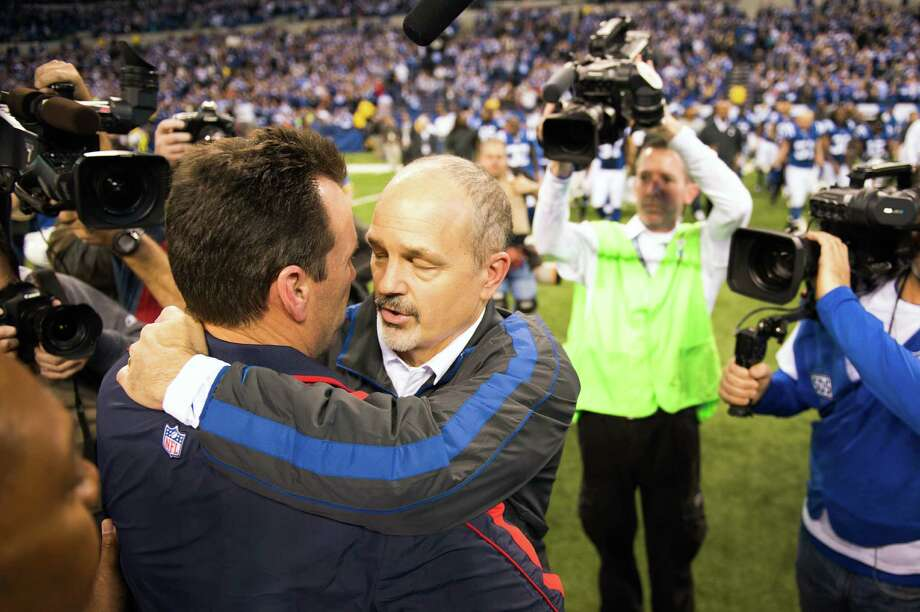 Colts head coach Chuck Pagano hugs Texans head coach Gary Kubiak following the Colts  28-16 victory. Photo: Smiley N. Pool, Houston Chronicle / © 2012  Houston Chronicle