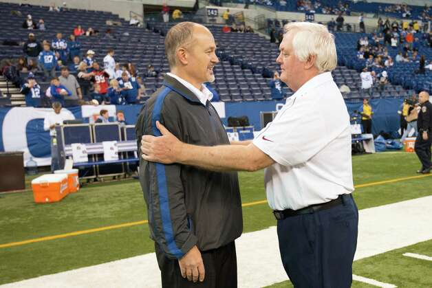 Texans defensive coordinator Wade Phillips, right, greets Colts head coach Chuck Pagano before the game. Photo: Smiley N. Pool, Houston Chronicle / © 2012  Houston Chronicle