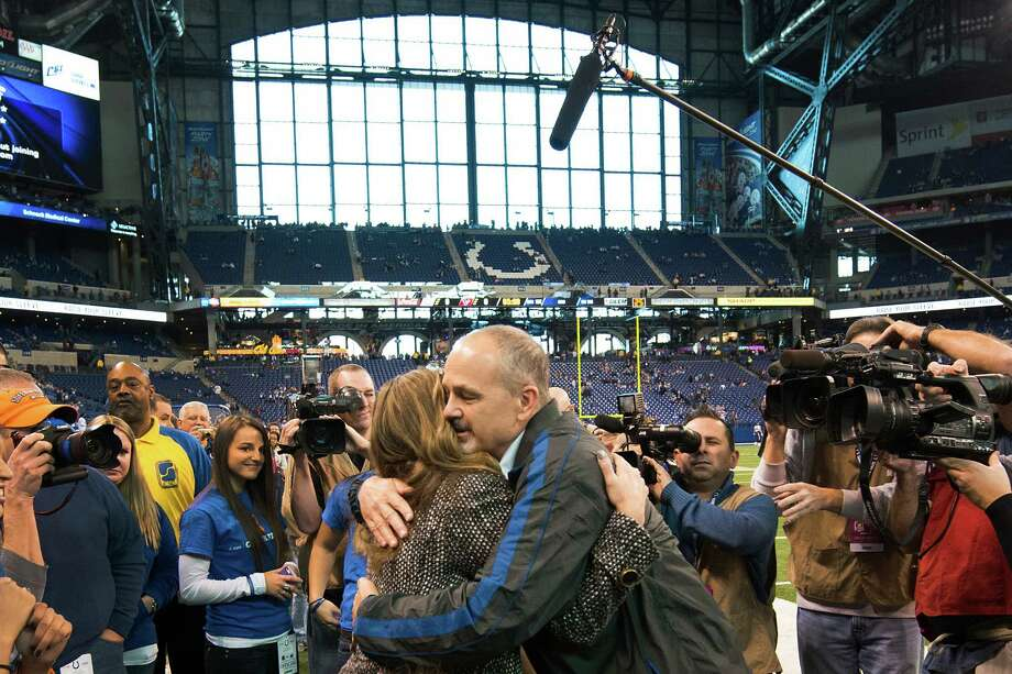 Colts head coach Chuck Pagano hugs his wife Tina Pagano before the game. Photo: Smiley N. Pool, Houston Chronicle / © 2012  Houston Chronicle