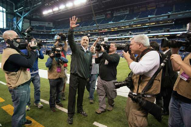 Colts head coach Chuck Pagano waves to the crowd. Photo: Smiley N. Pool, Houston Chronicle / © 2012  Houston Chronicle