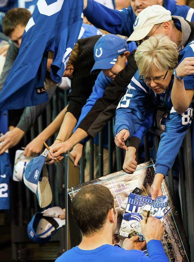 Colts quarterback Andrew Luck signs autographs for fans before the game. Photo: Smiley N. Pool, Houston Chronicle / © 2012  Houston Chronicle