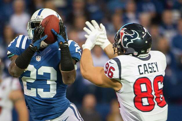 Colts cornerback Vontae Davis (23) intercepts a pass intended for Texans fullback James Casey (86) during the second quarter. Photo: Smiley N. Pool, Houston Chronicle / © 2012  Houston Chronicle