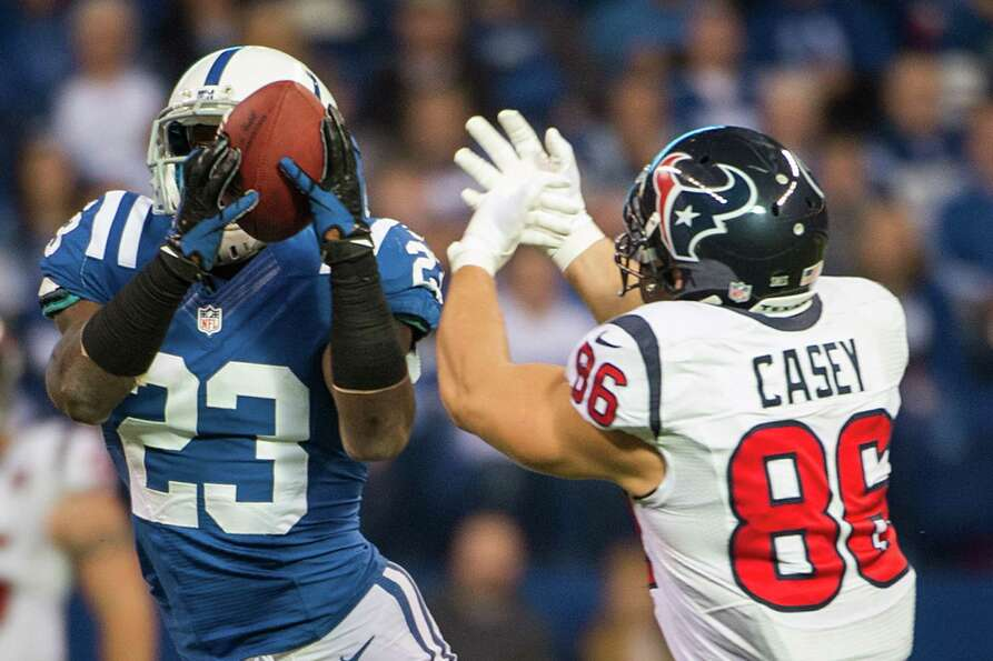 Colts cornerback Vontae Davis (23) intercepts a pass intended for Texans fullback James Casey (86) d