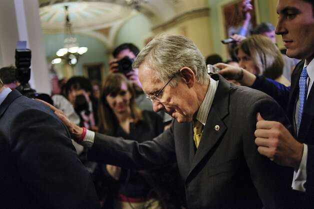 Senate Majority Leader Harry Reid, a Democrat from Nevada, is escorted through a crowd of reporters as he walks to the Senate Floor following a party caucus meeting at the U.S. Capitol in Washington, D.C., U.S., on Sunday, Dec. 30, 2012. Senate Majority Leader Harry Reid rejected the latest Republican offer to resolve the U.S. fiscal crisis as Minority Leader Mitch McConnell reached out to Vice President Joe Biden in an effort to break the impasse. Photographer: Pete Marovich/Bloomberg *** Local Caption *** Harry Reid Photo: Pete Marovich, Bloomberg