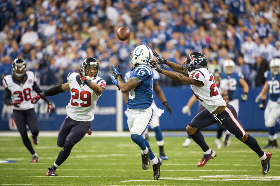 Colts wide receiver T.Y. Hilton (13) beats Texans cornerback Johnathan Joseph (24) and strong safety Glover Quin (29) as he hauls in a 70-yard touchdown pass during the fourth quarter. Photo: Smiley N. Pool, Houston Chronicle / © 2012  Houston Chronicle