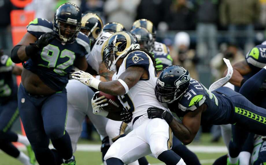 St. Louis Rams' Steven Jackson is tackled by Seattle Seahawks' Chris Clemons (91) in the first half of an NFL football game on Sunday in Seattle. Photo: AP Photo/Elaine Thompson