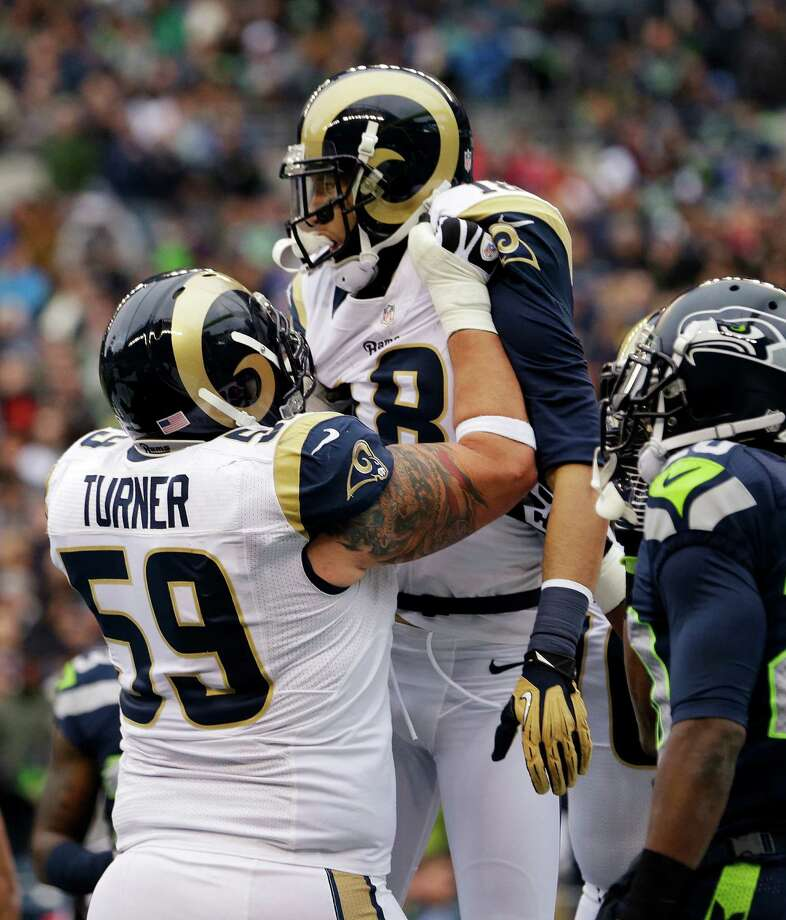 St. Louis Rams' Austin Pettis is lifted up by Robert Turner (59) after scoring on a pass reception against the Seattle Seahawks in the first half of an NFL football game, Sunday, Dec. 30, 2012, in Seattle. Photo: AP Photo/Elaine Thompson