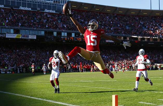 San Francisco 49ers wide receiver Michael Crabtree (15) scores on a 49-yard touchdown reception against the Arizona Cardinals during the second quarter of an NFL football game in San Francisco, Sunday, Dec. 30, 2012. (AP Photo/San Francisco Chronicle, Carlos Avila Gonzalez)  MANDATORY CREDIT; MAGAZINES OUT; TV OUT Photo: Carlos Avila Gonzalez, The Chronicle