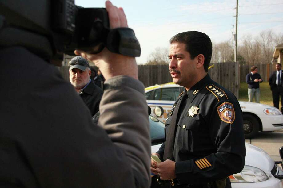 "Harris County Sheriff Adrian Garcia speaks to members of the media Sunday afternoon outside the West Houston home where two deputies Tasered then shot and killed a man who had been acting ""irrational."" One deputy was taken to the hospital with a concussion, bruises, cuts and a bite mark, Garcia said. The investigation is ongoing. Photo: Jayme Fraser, Chronicle / Houston Chronicle"