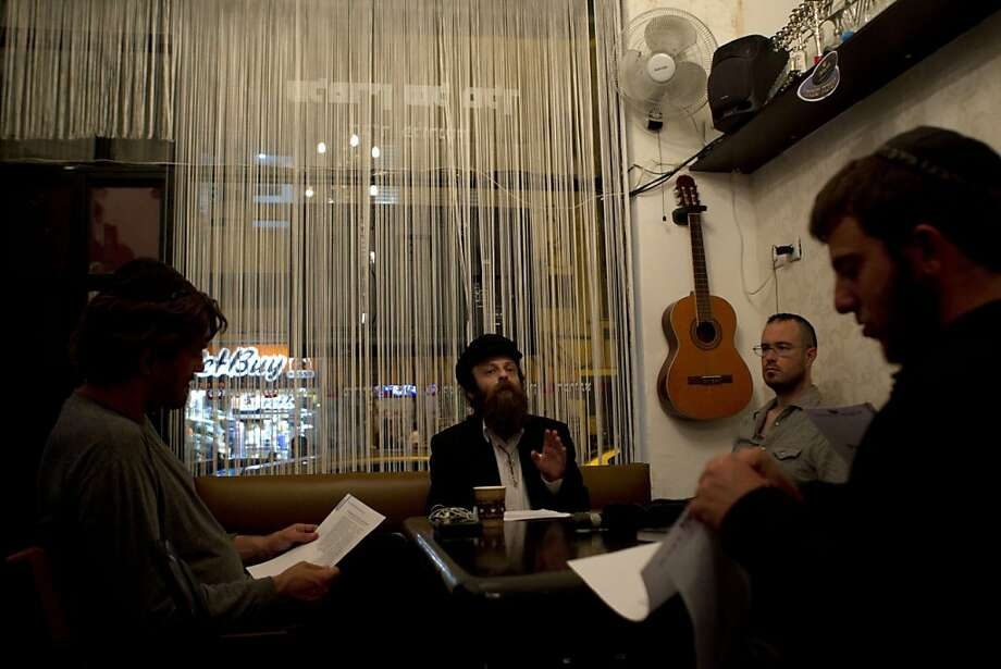 Shmuel Hapartzy (center), founder of the Cain and Abel School for Prophets, talks with students. The idea of a prophet school offends many on the basis of both tradition and theology. Photo: Ariel Schalit, Associated Press