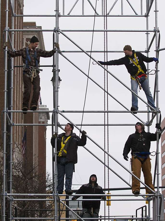 Crews set up the stage for Grand Rapids Hot New Year's Eve Party 2013, Sunday, Dec. 30, 2012 on Monroe Ave. in Grand Rapids, Mich. (AP Photo/The Grand Rapids Press, Sally Finneran) Photo: Sally Finneran, Associated Press
