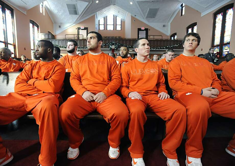 In a photo provided by Chick-fil-A, Clemson athletes sit during a visit to Ebenezer Baptist Church where the Rev. Dr. Martin Luther King Jr. preached, during their Chick-fil-A Bowl visit to the Martin Luther King Jr. National Historic Site, Sunday, Dec. 30, 2012, in Atlanta. Clemson plays LSU in the Chick-fil-A Bowl at the Georgia Dome on Monday. (AP Photo/Chick-fil-A, David Tulis) Photo: Dave Tulis, Associated Press