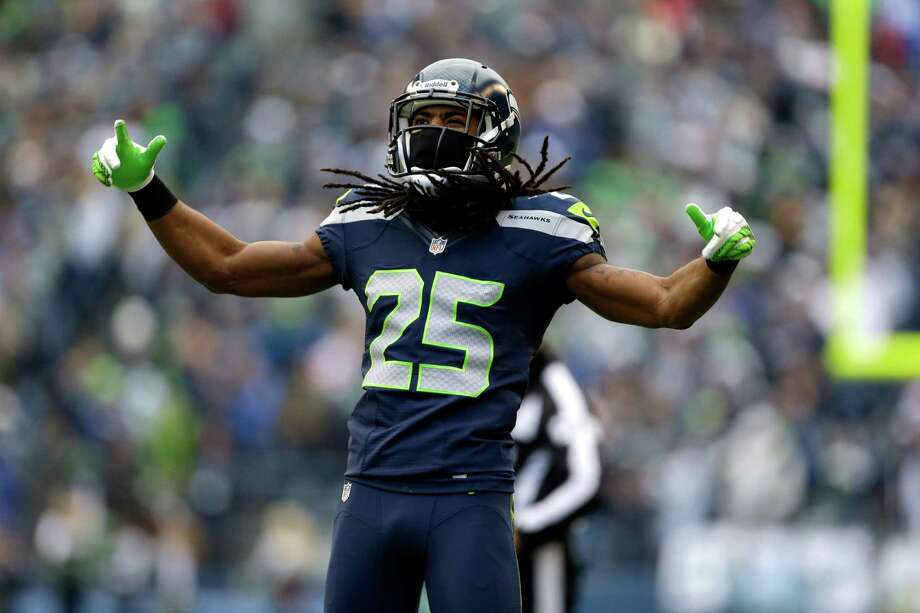Seattle Seahawks' Richard Sherman reacts to a play against the St. Louis Rams in the first half of an NFL football game, Sunday in Seattle. Photo: AP Photo/Elaine Thompson