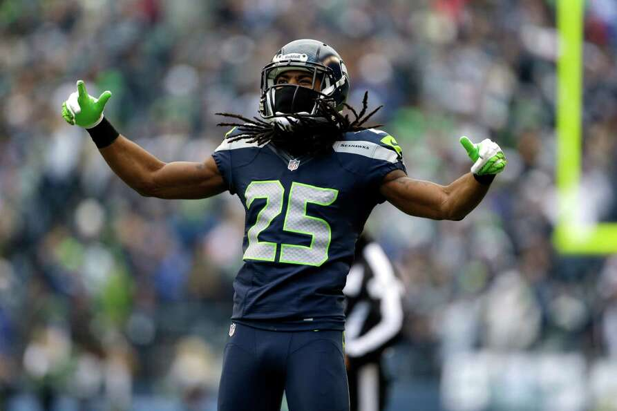 Seattle Seahawks' Richard Sherman reacts to a play against the St. Louis Rams in the first half of a