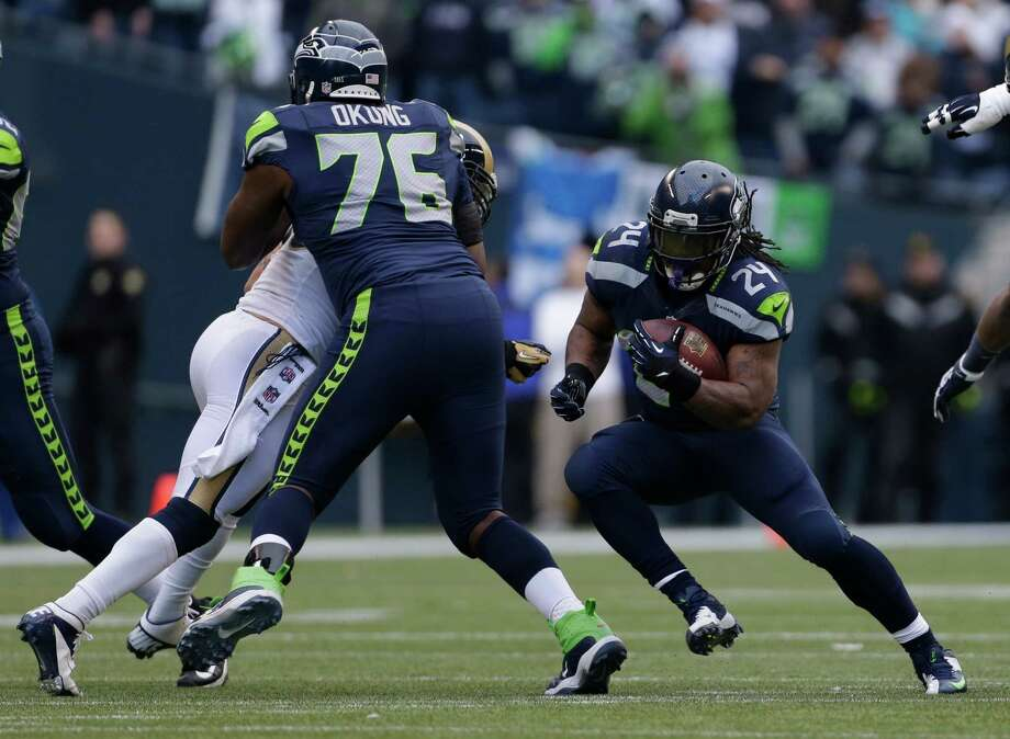 Seattle Seahawks' Marshawn Lynch (24) rushes as Russell Okung (76) blocks in the first half of an NFL football game against the St. Louis Rams, Sunday in Seattle. Photo: AP Photo/Elaine Thompson