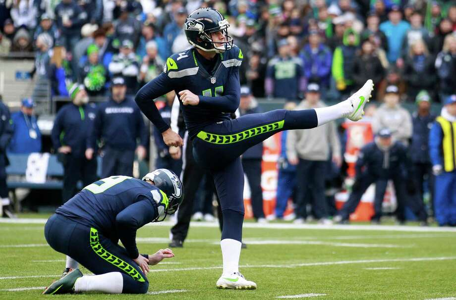 Seattle Seahawks' Steven Hauschka kicks a field goal as Jon Ryan holds for him in the first half of an NFL football game against the St. Louis Rams, Sunday in Seattle. Photo: AP Photo/Elaine Thompson