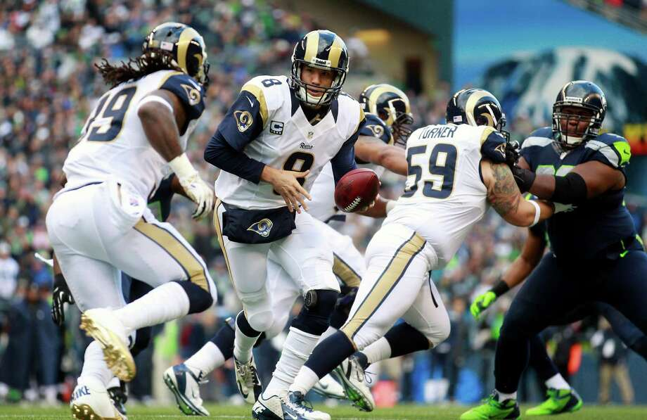 St. Louis Rams quarterback Sam Bradford (8) hands off to Steven Jackson, left, in the first half of an NFL football game against the Seattle Seahawks, Sunday, Dec. 30, 2012, in Seattle. () Photo: AP Photo/Elaine Thompson