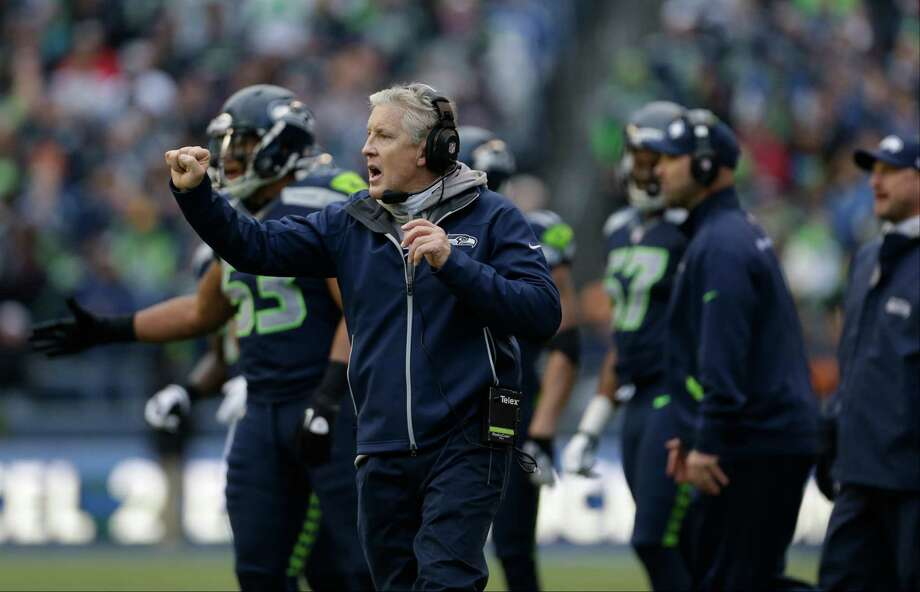 Seattle Seahawks head coach Pete Carroll calls to his team in the first half of an NFL football game against the St. Louis Rams, Sunday in Seattle. Photo: AP Photo/Elaine Thompson