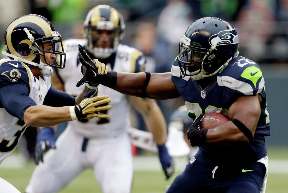 St. Louis Rams' Cortland Finnegan, left, chases Seattle Seahawks' Robert Turbin in the first half of an NFL football game, Sunday in Seattle. Photo: AP Photo/Elaine Thompson