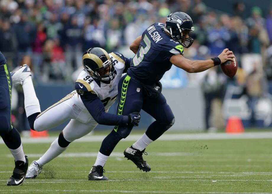 Seattle Seahawks' Russell Wilson in action against the St. Louis Rams in the first half of an NFL football game, Sunday in Seattle. Photo: AP Photo/Elaine Thompson