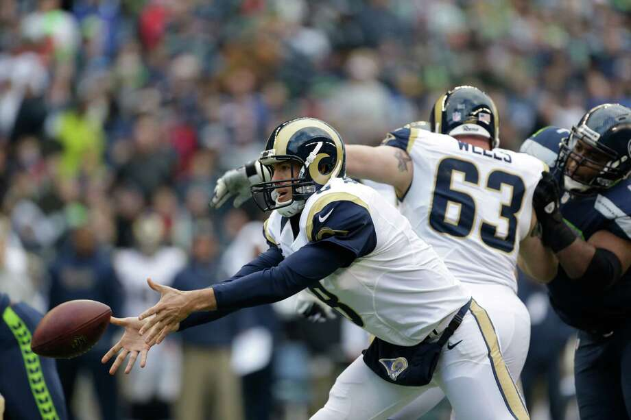 St. Louis Rams' Sam Bradford in action against the Seattle Seahawks in the first half of an NFL football game, Sunday in Seattle. Photo: AP Photo/Elaine Thompson