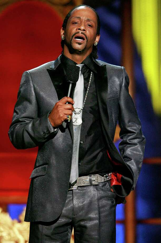 """In this Sunday, July 22, 2007 photo, Katt Williams performs onstage during the """"Comedy Central Roast of Flavor Flav,"""" in Burbank, Calif. Williams found himself on the wrong side of the law after being arrested in Los Angeles, Friday, Dec. 28, 2012, on suspicion of child endangerment and possession of a stolen gun. Police Officer Norma Eisenman says Williams was taken into custody Friday after the Los Angeles County Department of Children and Family Services did a welfare check at his home. Authorities found more than one firearm, one of which had been reported stolen. (AP Photo/Matt Sayles) Photo: Matt Sayles"""