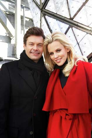 Entertainers Ryan Seacrest, left, and Jenny McCarthy, hosts of Dick Clark's New Year's Rockin' Eve on ABC, pose for a portrait Friday, Dec. 28, 2012 in New York. As New Year's Eve nears, Seacrest is focused on getting ready for the show, which, with related programming, will blanket ABC from 8 p.m. until past 2 a.m. EST. (Photo by Dan Hallman/Invision/AP Images) Photo: Dan Hallman
