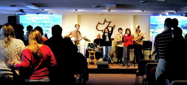 "The Worship Band performs before Crystal Miller, a survivor of the 1999 Columbine High School shooting in Colo., spoke during ""Hope out of Tragedy"" at Calvary Chapel in Southbury, Conn., Sunday, Dec. 30, 2012. Photo: Michael Duffy / The News-Times"