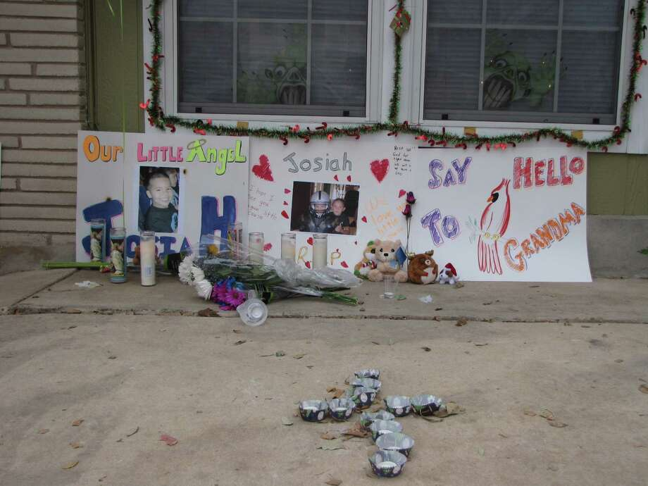 A growing pile of stuffed animals, candles and flowers have been placed in front of handmade posters at a South Side home where 5-year-old Josiah Williams died last week. Photo: Eva Ruth Moravec, San Antonio Express-News