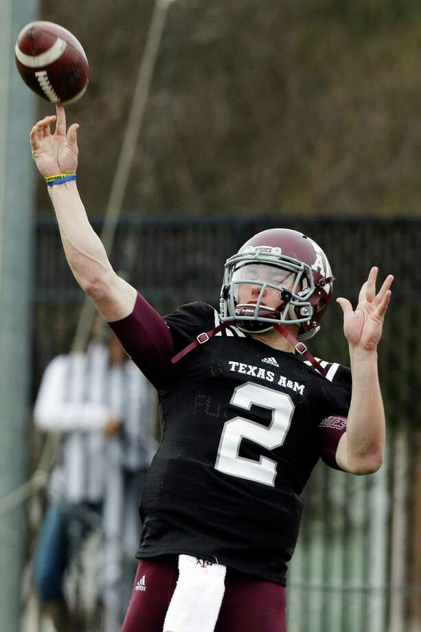 Texas A&M quarterback Johnny Manziel (2) passes during practice for the Cotton Bowl NCAA college football game, Sunday, Dec. 30, 2012, in Dallas. Texas A&M is scheduled to play Oklahoma on Jan. 4, 2013. (AP Photo/LM Otero) Photo: LM Otero, Associated Press / AP