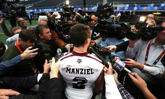 Texas A&M quarterback Johnny Manziel (2) talks to reporters during media day for the Cotton Bowl Classic NCAA college football game at Cowboys Stadium, Sunday, Dec. 30, 2012, in Arlington, Texas. Oklahoma and Texas A&M are scheduled to play on Jan. 4, 2013. (AP Photo/LM Otero) Photo: LM Otero, Associated Press / AP