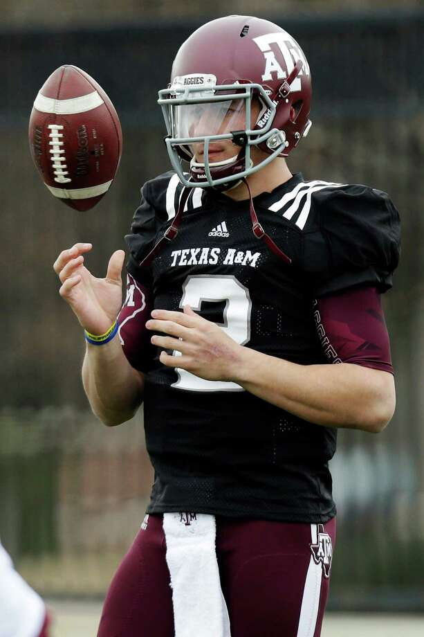 Texas A&M quarterback Johnny Manziel (2) tosses a ball during practice for the Cotton Bowl NCAA college football game, Sunday, Dec. 30, 2012, in Dallas. Texas A&M is scheduled to play Oklahoma on Jan. 4, 2013. (AP Photo/LM Otero) Photo: LM Otero, Associated Press / AP
