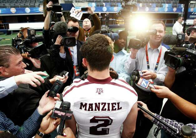 Texas A&M Aggies quarterback Johnny Manziel (2) answers questions from the media during the Cotton Bowl Media Day at Cowboys Stadium Sunday, December 30, 2012. (Richard W. Rodriguez/Fort Worth Star-Telegram/MCT) Photo: Richard Rodriguez, McClatchy-Tribune News Service / Fort Worth Star-Telegram
