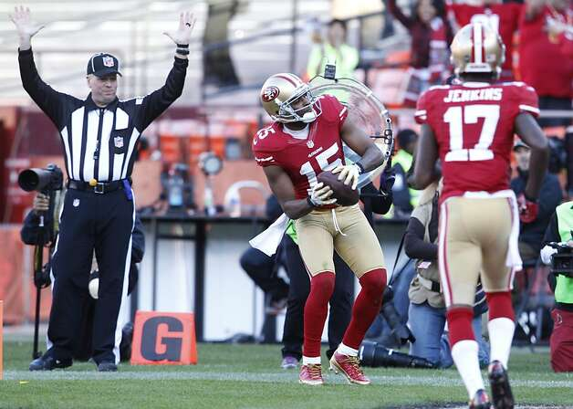 Wide receiver Michael Crabtree (15) celebrates by throwing the ball into the stands after a touchdown in the third quarter of the San Francisco 49ers game against the Arizona Cardinals at Candlestick Park in San Francisco, Calif., on Sunday December 30, 2012. Photo: Carlos Avila Gonzalez, The Chronicle