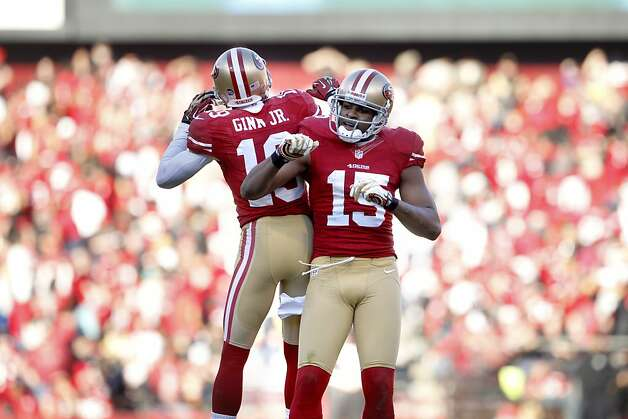 49ers Wide receiver Michael Crabtree (15) celebrates with  Wide receiver Ted Ginn Jr. (19) following his third touchdown of the game against the Arizona Cardinals at Candlestick Park in San Francisco, Calif., on Sunday December 30, 2012. Photo: Carlos Avila Gonzalez, The Chronicle