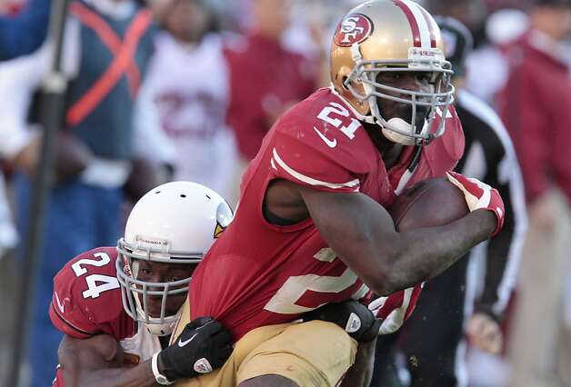 Running back Frank Gore (21) runs through  tackle by Arizona Cardinals safety Adrian Wilson (24) during the second half of the San Francisco 49ers game against the Arizona Cardinals at Candlestick Park in San Francisco, Calif., on Sunday December 30, 2012. Photo: John Storey, Special To The Chronicle