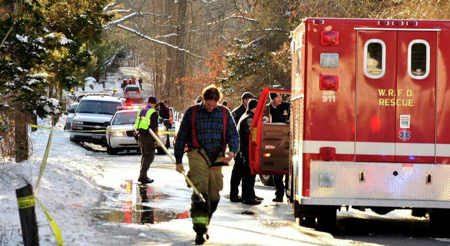 First responders attend the scene where a car was hit by a train near the intersection of Simpaug Turnpike and Long Ridge Road in West Redding Center, Conn., Sunday, Dec. 30, 2012. Photo: Michael Duffy